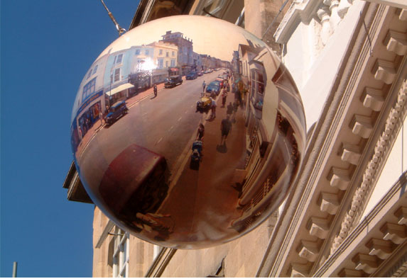 "<img height=573 src=""images-Orrery/CAFE%20EXTERIOR_2007.jpg"" width=394 border=3 alt=""The Orrery cafe is located at 15 Union st ryde, it has a very fine planetarium of our solar system which is geared so that the planets all orbit the sun , the cafe is theemed with Alice in Wonderland and Alice through the Looking Glass art work on the cafe walls, but why do you ask this? whay would a planetarium have images of a known childrens book on the walls and ceiling? This is because of a recent theory that convincingly shows that Charles Dodgson (Lewis Carroll), used the known constellations of the nights sky as inspiration for their Alice Books. So this is why Alice and friends have taken up residence in the Orrery Cafe in Ryde! The cafe is Vegetarian, and there are other Alice related items to be found when  you visit the cafe, the floor is a giant chess board, which true to form get smaller when you decend the spiral staircase to the basement floor, here the tiles shrink, and upon entering the two loos, they shrink yet again, also when decending the Orrery staircase  one passes a large light which looks like a giant jar of marmalade. The cafe is the first stage of converting a derelict building which has been vacant for many years and it is our hope to transform the whole building into a fun globe museum with one of the largest optical illusions in the country. The planetarium is over 16 ft diameter and is best viewed through the 8 mirrored top tables actually reveal 8 far finer plaetariums by looking through the tables a far superior vantage point of the Orrery's planetariums. Thank you for your interest, we hope one day you might consider journeying across the Solent so that you can see the Orrery first hand."">"