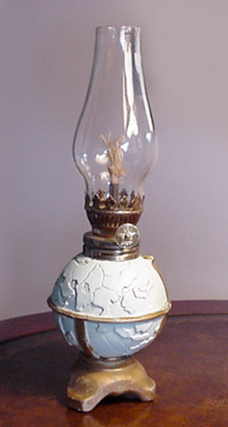 oil lamp with relief globe base  - greaves and thomas make a diverse range of terrestrial globes, globes of the world, world globe, world globes, celestial globes, planetry globes, lunar globes, customised globes, customised world globes, customised globes of the world, paper globes